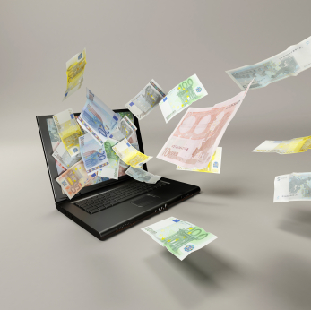 banknotes and laptop